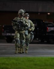 Wisconsin National Guard members are stationed outside the Green Bay Police Department Monday night. Extra security around downtown buildings was in place after protests turned violent the night before in downtown Green Bay.