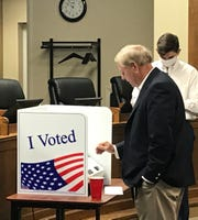 U.S. Sen. Lindsey Graham casts an absentee ballot in Walhalla on Monday for the June 9 primaries.