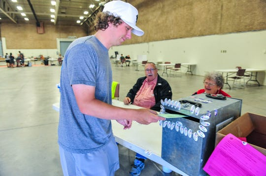 Ben Kaul submits his primary ballot on Tuesday afternoon at Montana ExpoPark, June 2, 2020.