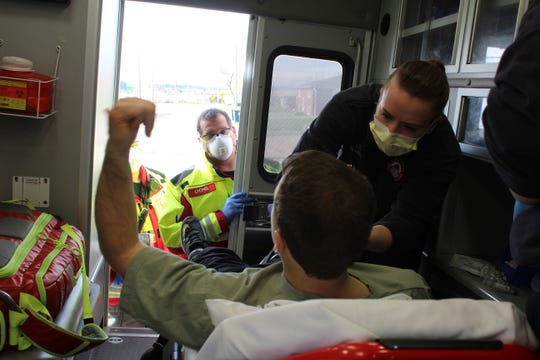 Paramedic Lily Wilson examines a patient before transport to Benefis Health System