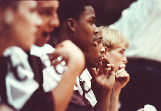 Henderson County players watch intently on the bench as the final minutes tick down during the 1999 Second Regional semifinal overtime game against Madisonville.