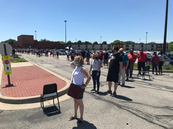 Voters wait in line to cast ballots in Tuesday's primary election at North Central High School in Indianapolis' Washington Township. Two school referendums were on the ballot in that township, one to boost operating expenses and another for capital projects.