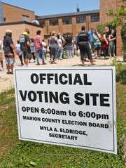 People wait in line to vote in the Indiana Primary, at the voting site in the former Broad Ripple High School, Tuesday, June 2, 2020.  In the afternoon, voters said they waited about two hours to vote.
