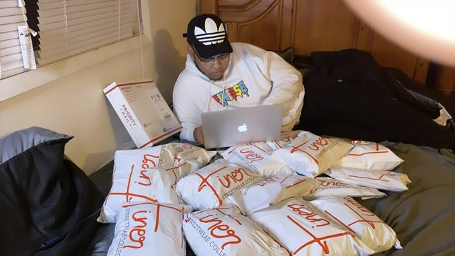 Local small business owner Markeece Johnson shipping out orders for his online store, Finer Streetwear Co., during the COVID-19 pandemic in the first half of 2020.
