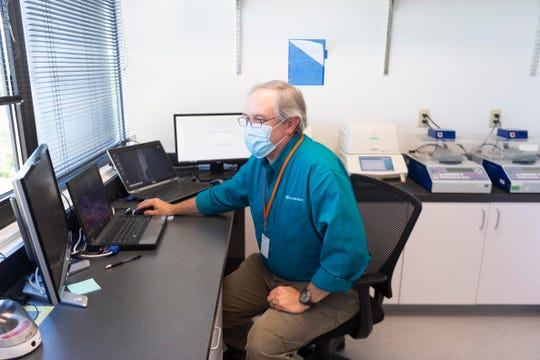 Robert Brooks, technical director and operations for Microbac Laboratories in Oak Ridge sits in the laboratory where they analyze the test kits used to find SARS-CoV-2 virus on surfaces.
