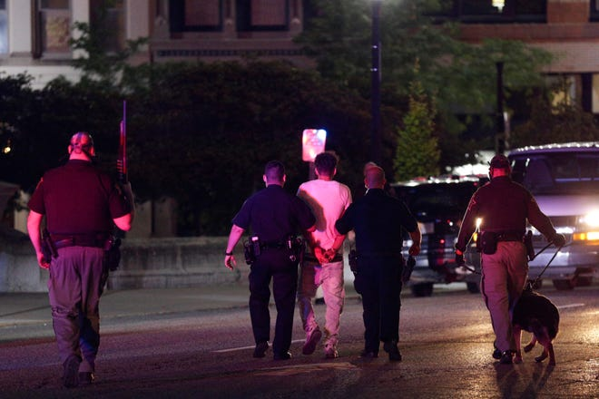A man is taken into custody as protesters rally in downtown Lafayette, Monday, June 1, 2020 in Lafayette.