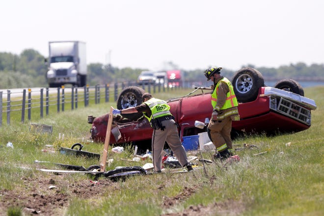 Emergency crews work the scene of a single vehicle rollover on I-65, three miles south of the Indiana 38 exit, Tuesday, June 2, 2020 in Lafayette.