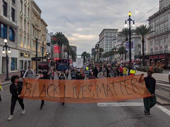 Protesters in New Orleans call for justice and police reform on June 1, 2020, after the police killing of Georga Floyd