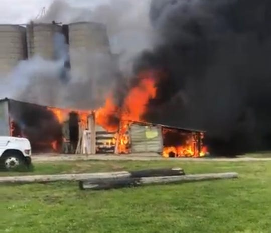 Crews responded to a barn fire in the 13000 block of Highland Road in Hartland Township on Monday, June 1, 2020.