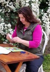 Heather Allard, paper quilling artist, in her garden.