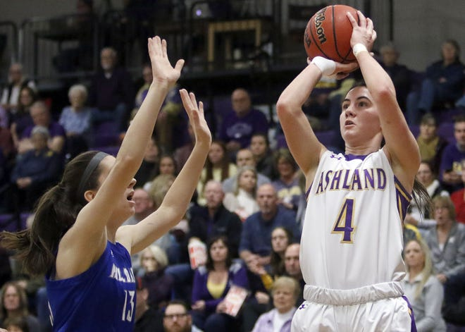Ashland University's Renee Stimpert (4) shoots over Hillsdale College's Courtney Krol (13) during college women's basketball Friday, Dec. 20, 2019 at Kates Gymnasium.