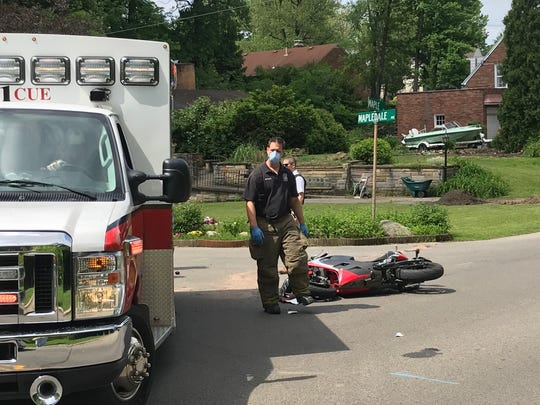 A motorcyclist was injured Tuesday on Maple Street after colliding with a car. The motorcyclist was transported to a hospital for treatment. Lou Whitmire/News Journal