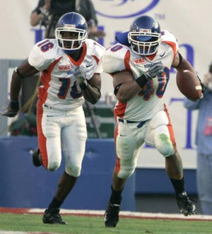 Boise State linebacker Andy Avalos (right) returns an interception 92 yards for a touchdown in the first quarter of the 2004 Liberty Bowl. Despite his record-setting effort, the Broncos dropped a 44-40 decision to Louisville.