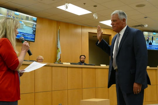 Marco Island City Councilor Greg Folley is sworn in during a meeting on June 1, 2020.