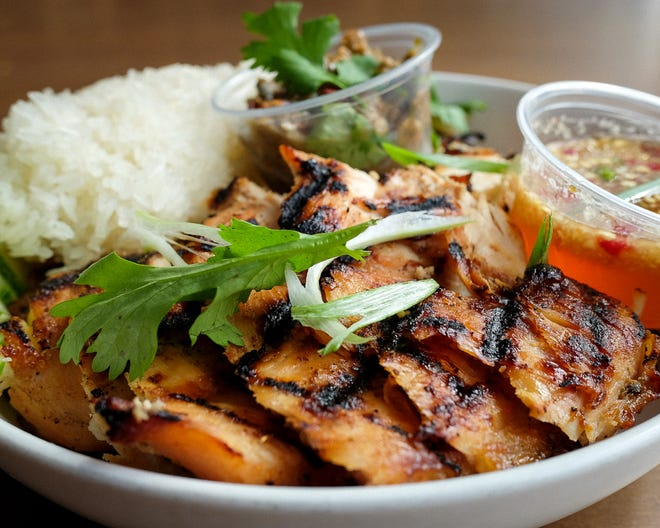 Grilled chicken and sticky rice is a dish served by Thum, the new Lao vendor at Crossroads Collective food hall, 2238 N. Farwell Ave. It will be open for four months, starting June 3.