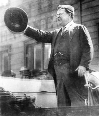 Theodore Roosevelt speaking from a car in Milwaukee on Oct. 14, 1912, shortly before a gunman shot and wounded him in front of the Gilpatrick Hotel. This photo shows the former president speaking from an automobile on the south side. He gave a number of talks, including one at the Deutscher Club (now the Wisconsin Club), before going to the Gilpatrick to rest before his major address at the Auditorium, which he made despite his wounds.