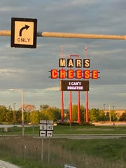 "Mars Cheese Castle added the words ""I can't breathe"" to its sign. Photograph by Matthew MacCarron."