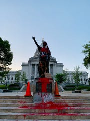 The state Capitol's Forward statue was doused in red paint Monday night.