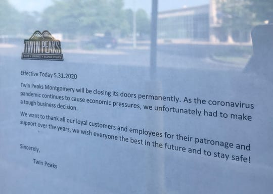 A note taped to the door of Twin Peaks in east Montgomery explains that the restaurant has permanently closed.