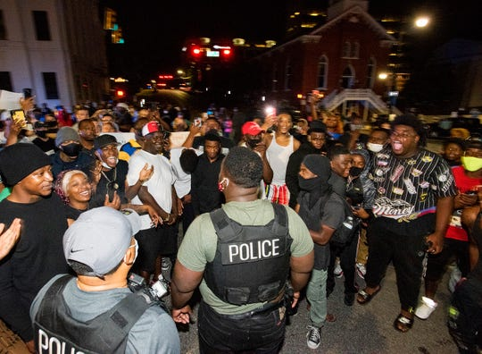 Protestors taunt police officers as they take to Dexter Avenue in front of the State Capitol Building in Montgomery, Ala., on Monday night June 1, 2020. They were demanding justice for George Floyd.