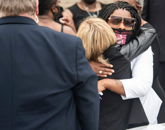 "Keena Smith- Talley is hugged by friends and family following her son, Jamari ""Chop"" Smith's funeral service at Pilgrim Rest Baptist Church in Montgomery, Ala., on Tuesday, June 2, 2020."