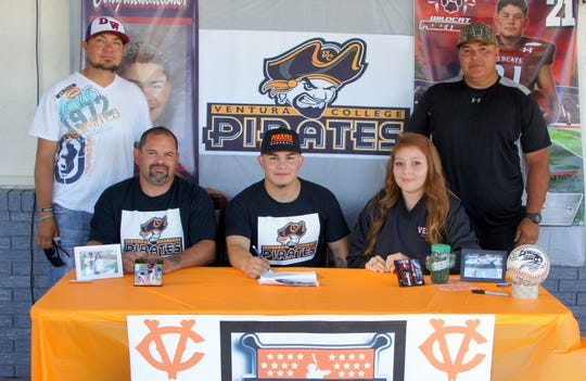 From left, Deming High Assistant Baseball Coach Saul Chavez, Fernie Munoz Sr. Fernie Munoz, Mimi Munoz and DHS Head Wildcat Baseball Coach Fernie Holguin were present on Saturday for the signing.