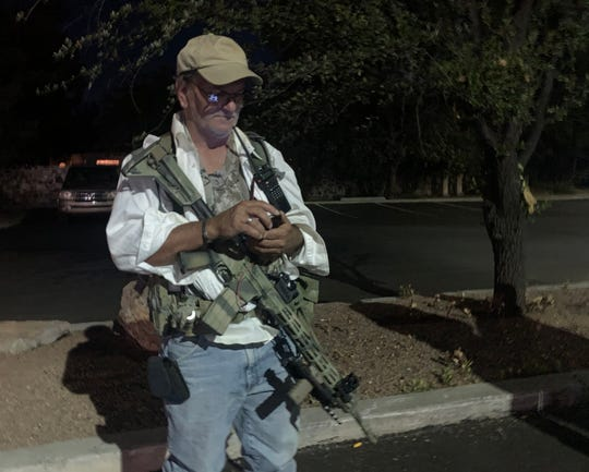 Las Cruces resident Dav Harzin said he heard intel that out of town protesters were in Las Cruces to wreak havoc on the peaceful protests that have been going on in the city. He and a group of other armed civilians gathered at a parking lot at the corner of Main Street and Picacho Avenue on Monday June 1, 2020, to protect both small businesses and protesters from potential demise should things become dicey.