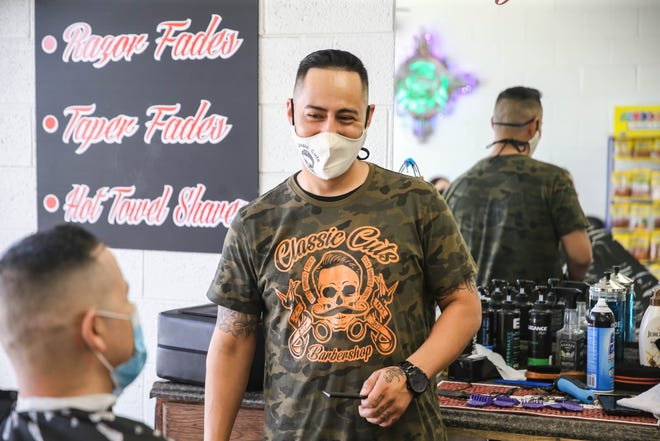 Juan Díaz Jr. cuts hair while wearing a mask at Classic Cuts Barbershop in Las Cruces on Tuesday, June 2, 2020.
