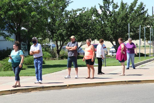 Voters wait in line to cast their ballots in the 2020 Primary Election on Tuesday, June 2, 2020, at the Farmington Museum at Gateway Park in Farmington.
