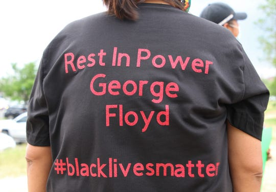 Community members participate in a protest on June 1 near the Animas Valley Mall in Farmington that called for justice in George Floyd's death in Minneapolis.