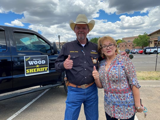 Candidate Micheal Wood for Lincoln county Sheriff and Alto resident, Estela Ambrose, give a thumps-up after casting her vote on June 2, 2020.