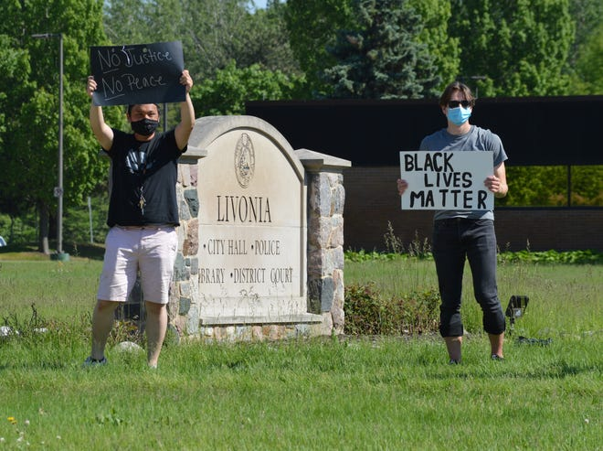 Protesters outside Livonia City Hall asking for racial equality in June 2020.