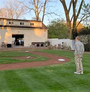 Eddie Zajdel admires his backyard field.