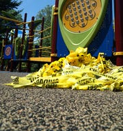 Leftover safety tape on the playground structure at Livonia's Rotary Park on June 2, 2020. The playground was officially closed until recently and yellow safety tape was used to keep people off the equipment.