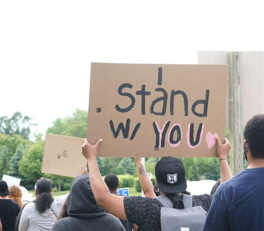 The protest outside the Westland Police Department drew a mixture of races to confront the brutal killing of George Floyd.