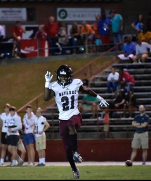 Navarre defensive back Kobe Johnson celebrates during an undated game during the 2020 season. Johnson is walking on to play football and run track at South Alabama.