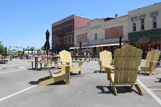 Local Eagle Scout candidate Cooper Kowal donated six Adirondack-style wooden chairs to the Meals on Madison outdoor patio dining area in downtown Port Clinton.