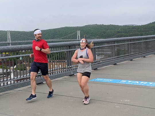 Fishkill resident and Pace University professor Angela Legg, running in the Walkway Mile, is proving that Dr. Vivek Murthy's book of the need for social connection is true.