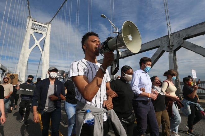 A protester leads a chant through a megaphone while marching on the Mid-Hudson Bridge during the Stop the Violence We Can't Breathe Protest in the City of Poughkeepsie on June 2, 2020.
