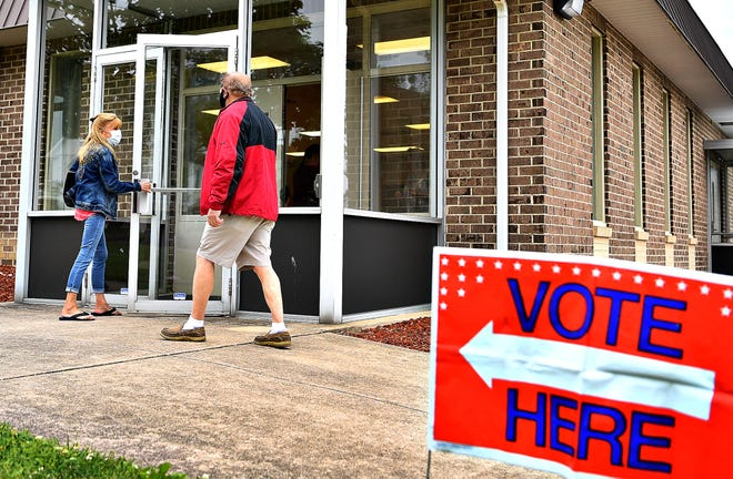 Judy Delp, left, and David Smith, both of Springettsbury Township, arrive to cast their vote at Commonwealth Fire Company #1 during Primary Election Day in Springettsbury Township, Tuesday, June 2, 2020. Dawn J. Sagert photo