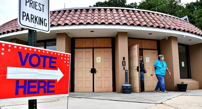 Voters exit Annunciation Greek Orthodox Church after voting in the Primary Election in York Township, Tuesday, June 2, 2020. Dawn J. Sagert photo