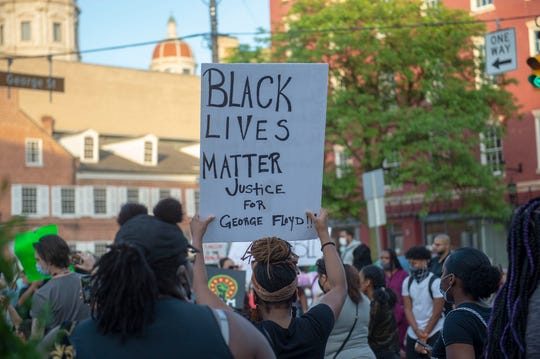 Approximately 200 people marched, chanted, spoke and carried signs from Penn Park to the Judicial Center in York in a protest on Monday, June 1, 2020.