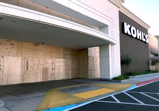 Plywood covers the windows at the Kohl's store in Redding on Tuesday, June 2, 2020, hours before an evening march is planned from the store to the Mt. Shasta Mall and back over the killing of George Floyd in Minneapolis.