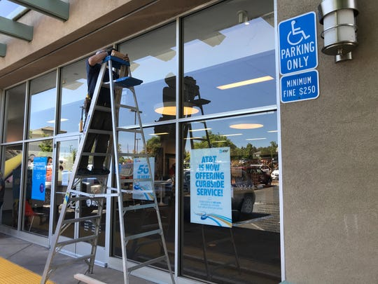Jeff Peacock of Peacock's Mobile Glass installs plywood over the windows at the AT&T Store on Browning Street on Tuesday, June 2, 2020. Business owners were boarding up their windows to guard against possible vandalism ahead of an evening protest in Redding over the killing of George Floyd.