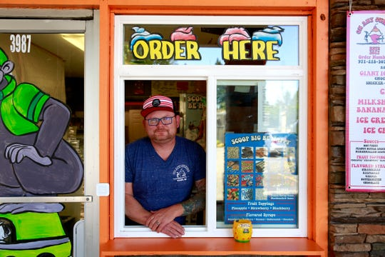 Owner Caleb Hayward stands in the new transaction window at On Any Sundae in Salem, Oregon, on Monday, June 1, 2020.