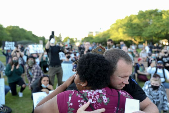 Alexis Christensen hugs Lieutenant Treven Upkes during a peaceful rally and march in Salem, Oregon on Monday, June 1, 2020. People gathered to protest the death of George Floyd by Minneapolis Police officers.