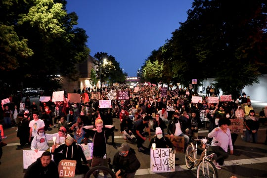 Protesters line the street during a peaceful rally and march in Salem, Oregon on Monday, June 1, 2020. People gathered to protest the death of George Floyd by Minneapolis Police officers.