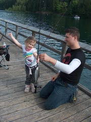 A lot of kids catch their first fish at Free Fishing Weekend events such as this one in 2011 at Hoover Campground at Detroit Lake.
