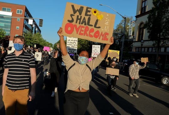 Demonstrators march during a peaceful rally and march in Salem, Oregon on Monday, June 1, 2020. People gathered to protest the death of George Floyd by Minneapolis Police officers.