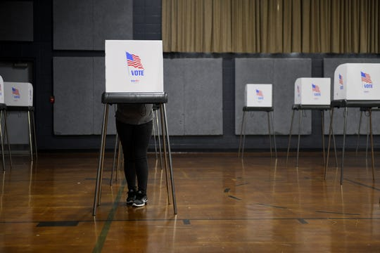 A voter stands in the Wicomico Civic Center in Salisbury on Primary Election Day, June 2, 2020. The center was the only in-person voting location in the county.